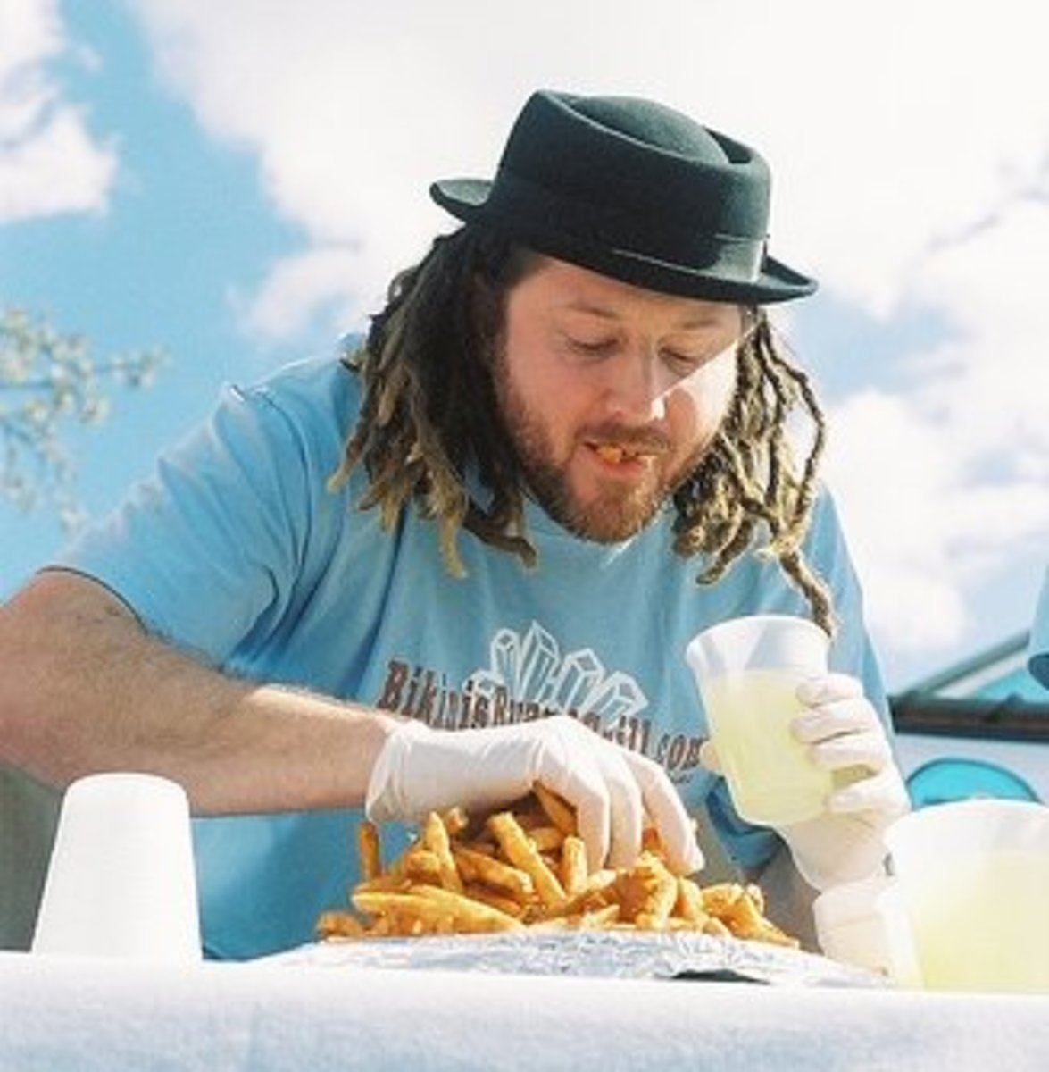 Crazy Legs Conti takes on a mountain of fries; the fries lose.