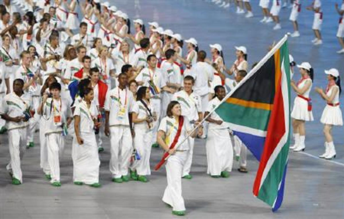 Natalie du Toit carrying flag of South Africa.