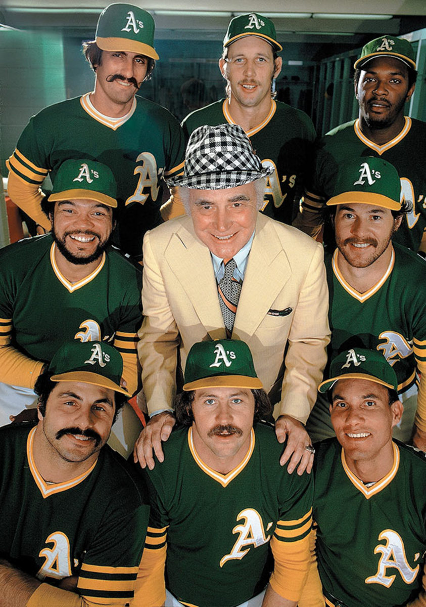 A's owner Charlie Finely with his stars.