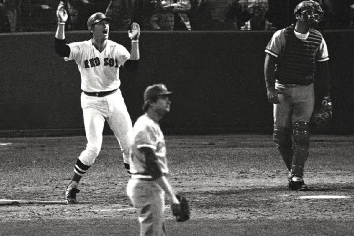 12th Inning, Game 6. Fisk urges his ball to the foul pole. Pitcher Pat Darcy looks on helplessly.