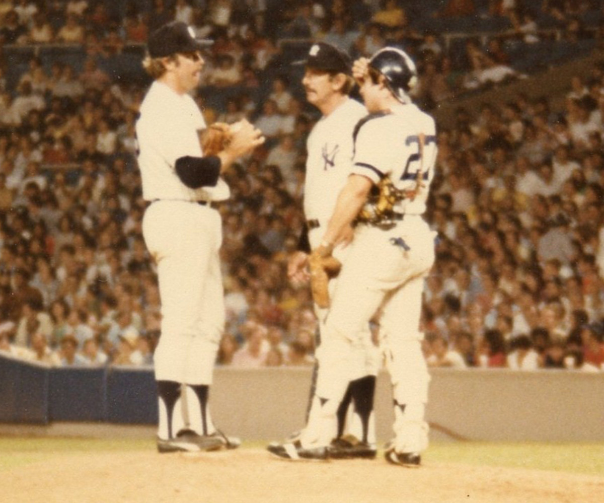 Billy Martin on the mound with Catfish Hunter, probably asking if he can gut it out to finish the game. Hunter had 30 complete games for Martin in 1975.