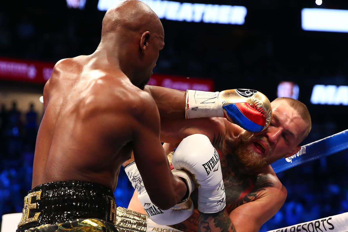 Notice Connor's lower hand holding back Floyd's.  That is exactly what a trap looks like and both men used this technique.