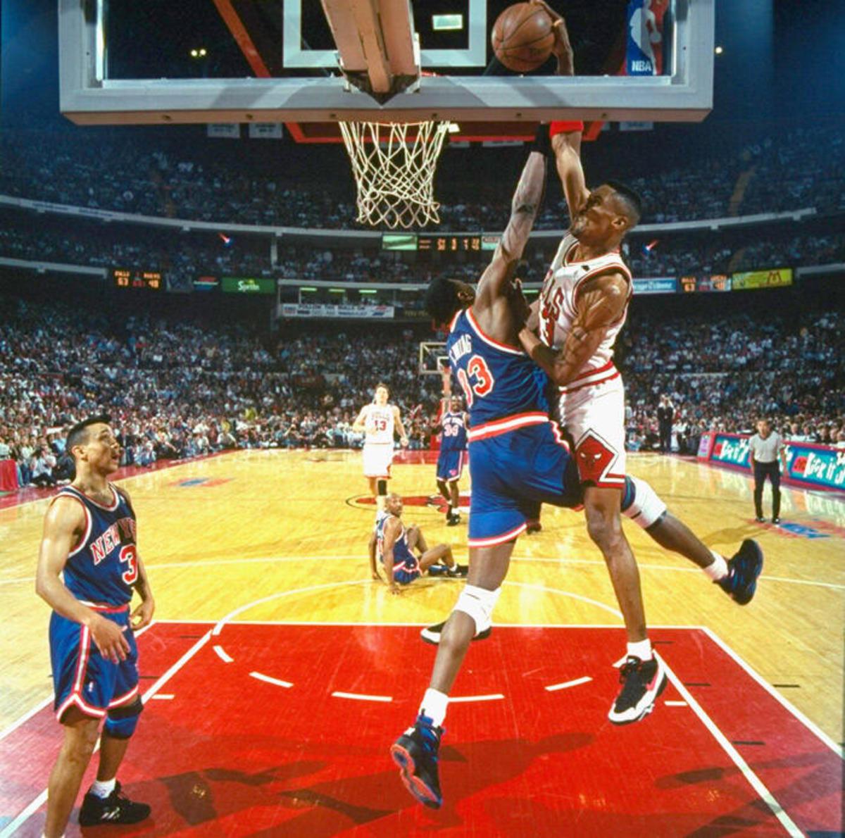 Scottie Pippen posterizes Knicks legend Patrick Ewing.