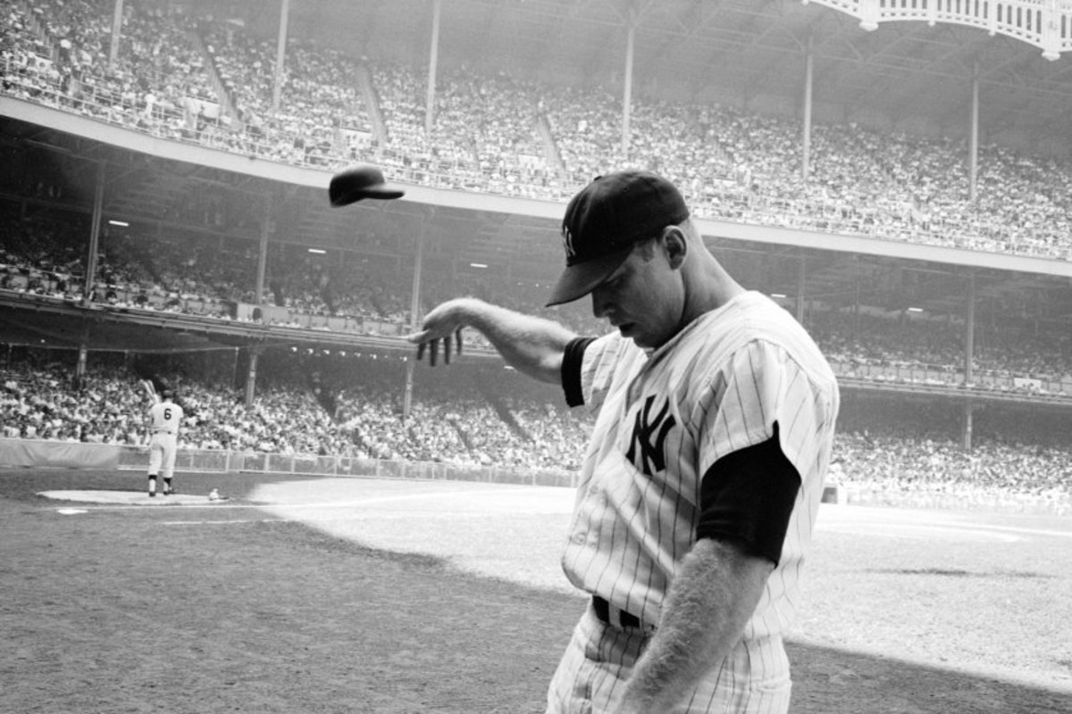 Iconic photo of Mickey tossing his helmet in disgust in the early 60s (Maris is on deck). After a decade of pain, frustration was showing.