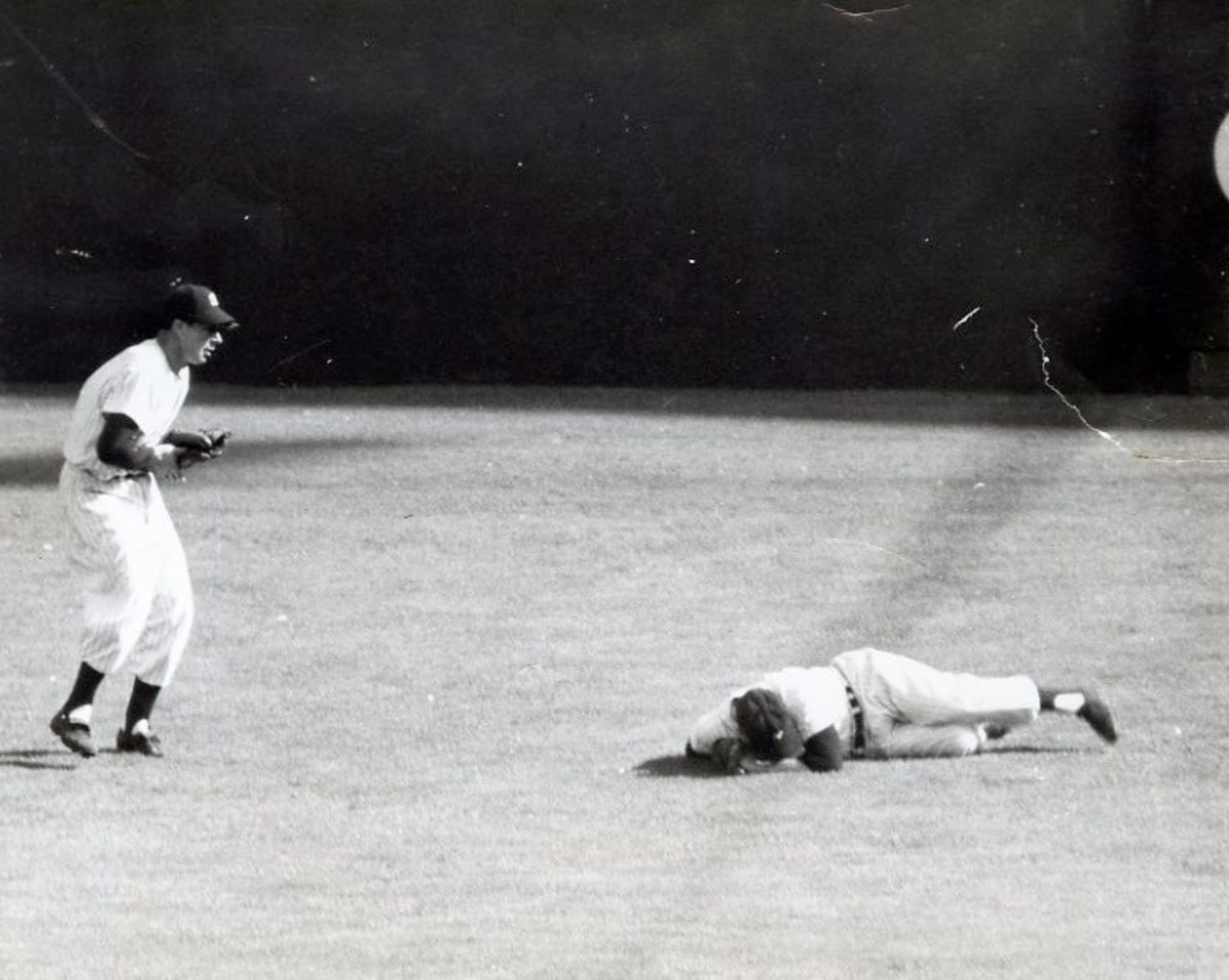Game 2, 1951 World Series: Dimaggio catches Mays' fly ball as Mantle sustains the first of many knee injuries.
