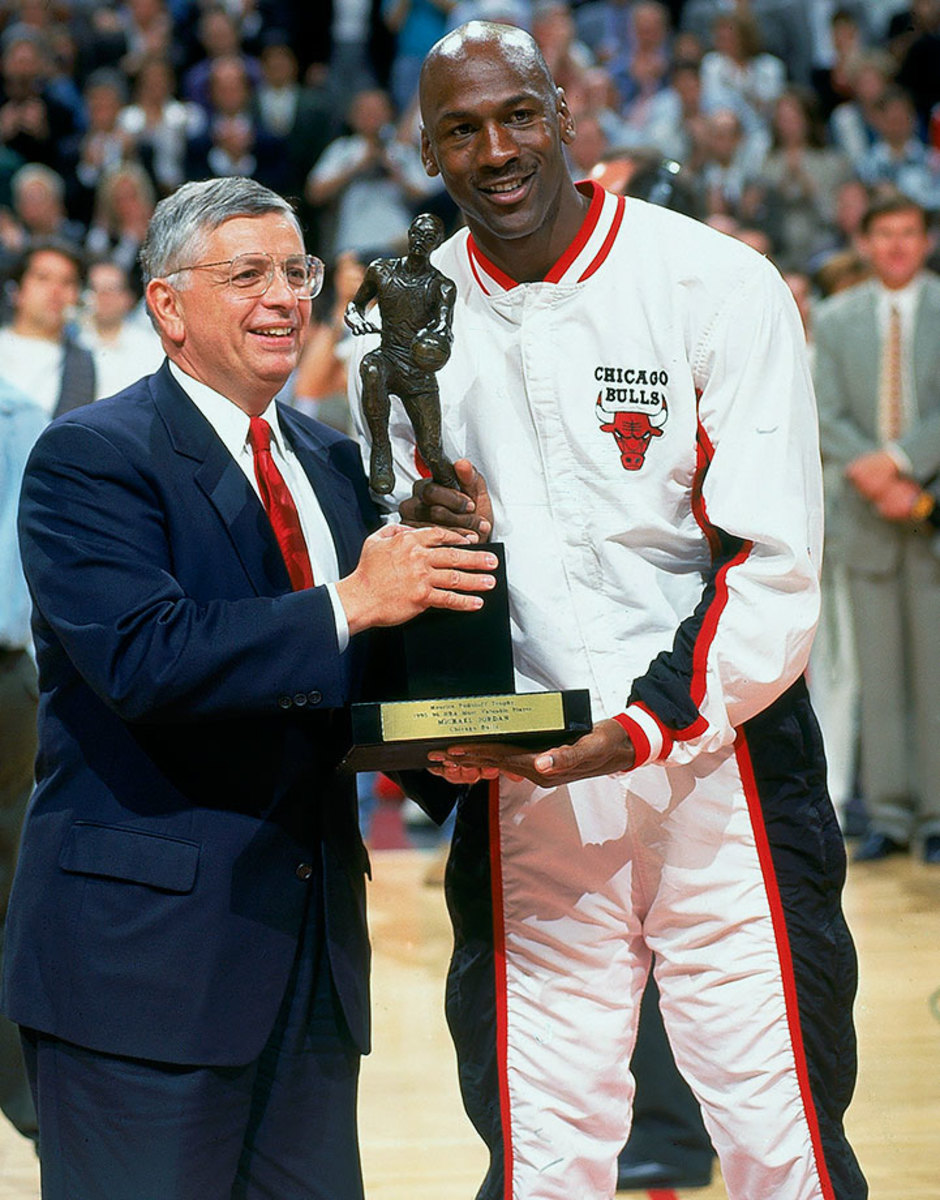 Michael Jordan receives the Maurice Podoloff trophy from David Stern.