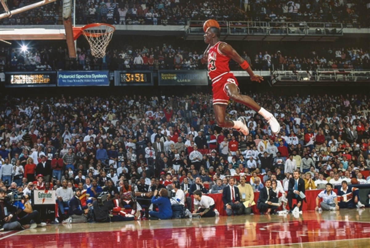 Michael Jordan hits his iconic free throw dunk.