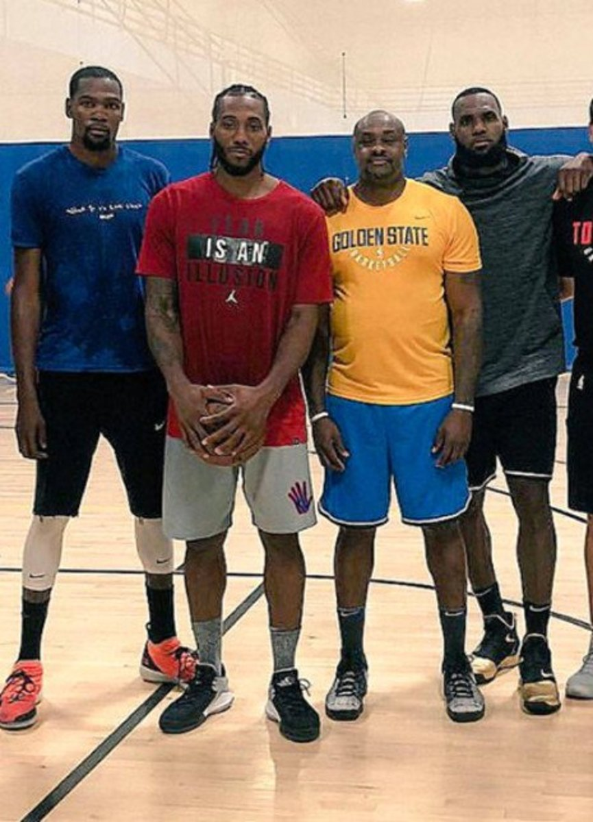 Kawhi Leonard (in red) is a small forward who is currently playing for the Los Angeles Clippers.