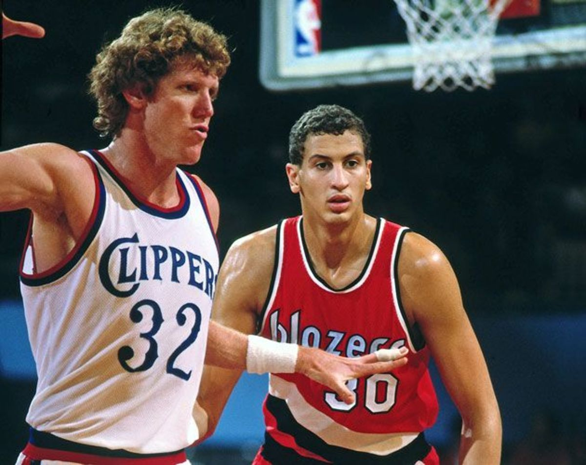 Sam Bowie jockeys for position with hall-of-famer Bill Walton.