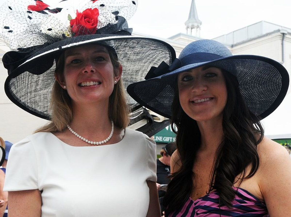 Two derby attendees proudly display their headware.