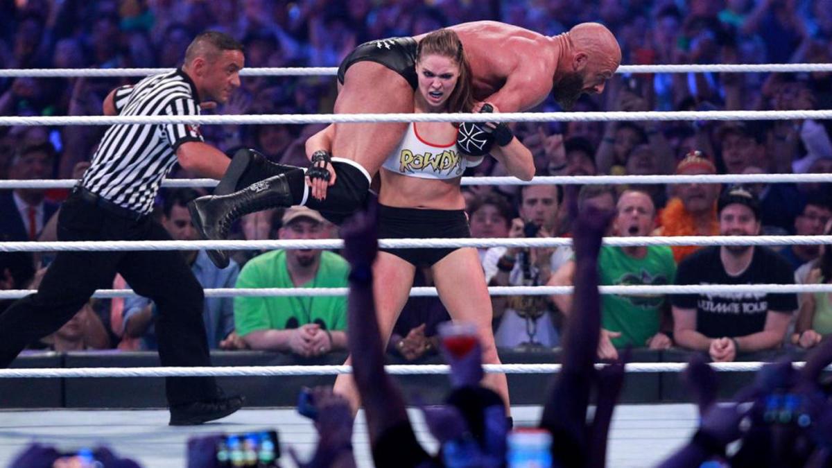 Ronda Rousey and Kurt Angle vs. Triple H and Stephanie McMahon