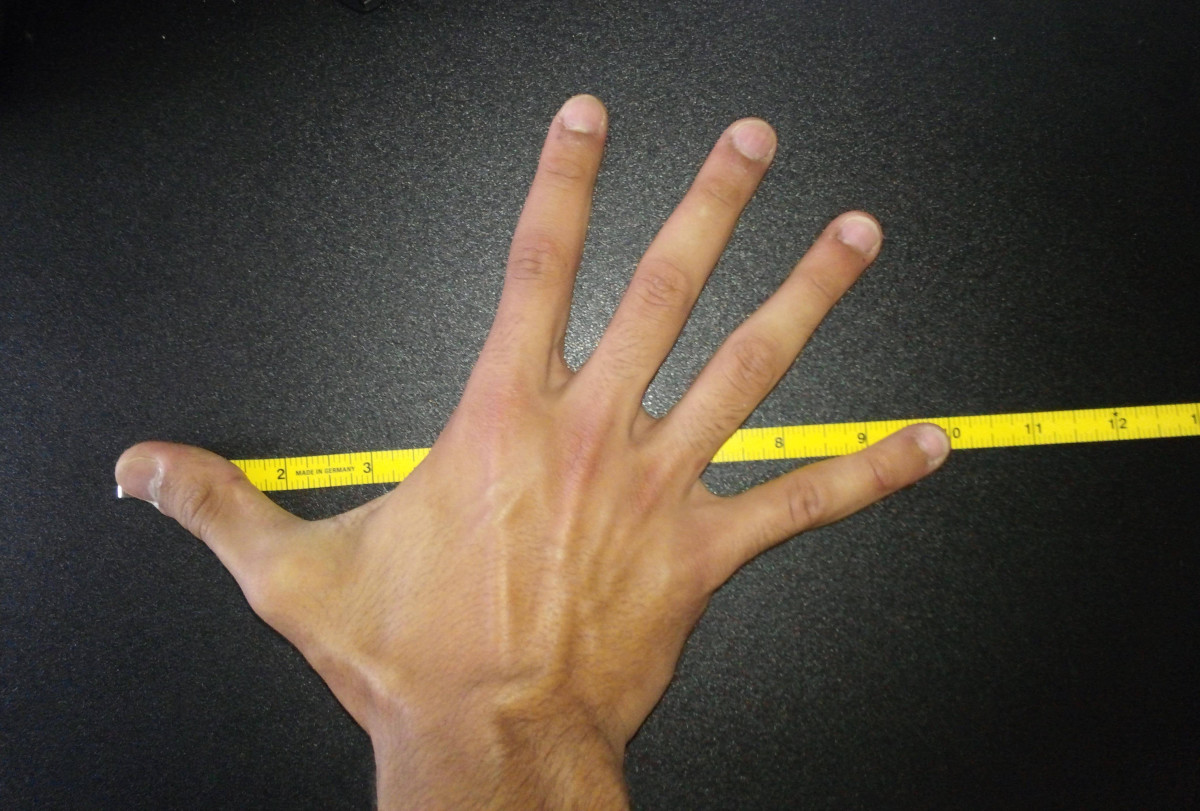 Hand size measurement at the NFL Combine is done by measuring the tip of the thumb to the tip of the pinky finger with the hand outstretched.