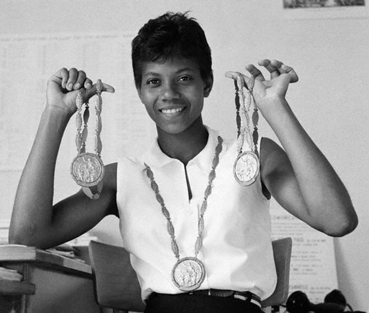 Wilma Rudolph showing her three Olympic gold medals