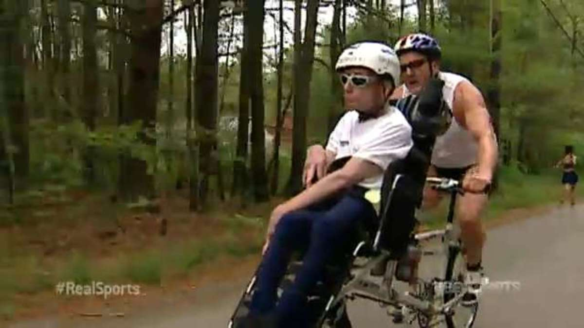 Dick and Rick Hoyt during bicycle portion of race.