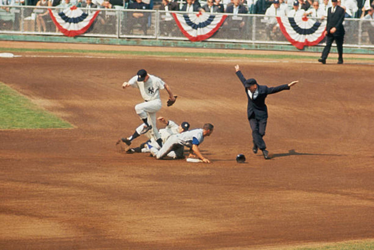 Wills slides in safe at second base after Al Downing's failed pick off attempt. Wills led the National League with 40 stolen bases. The year before he had set a record with 104. If he reached first, it was as good as a double.