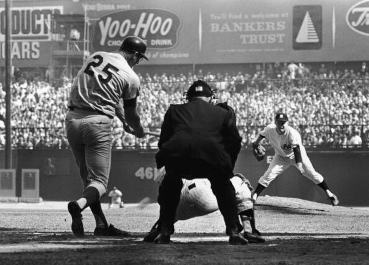 Frank Howard smashes a double off Whitey Ford in the 2nd inning. Ford called  him one of the scariest hitters he ever faced. Note the monuments in center field. They were in play.