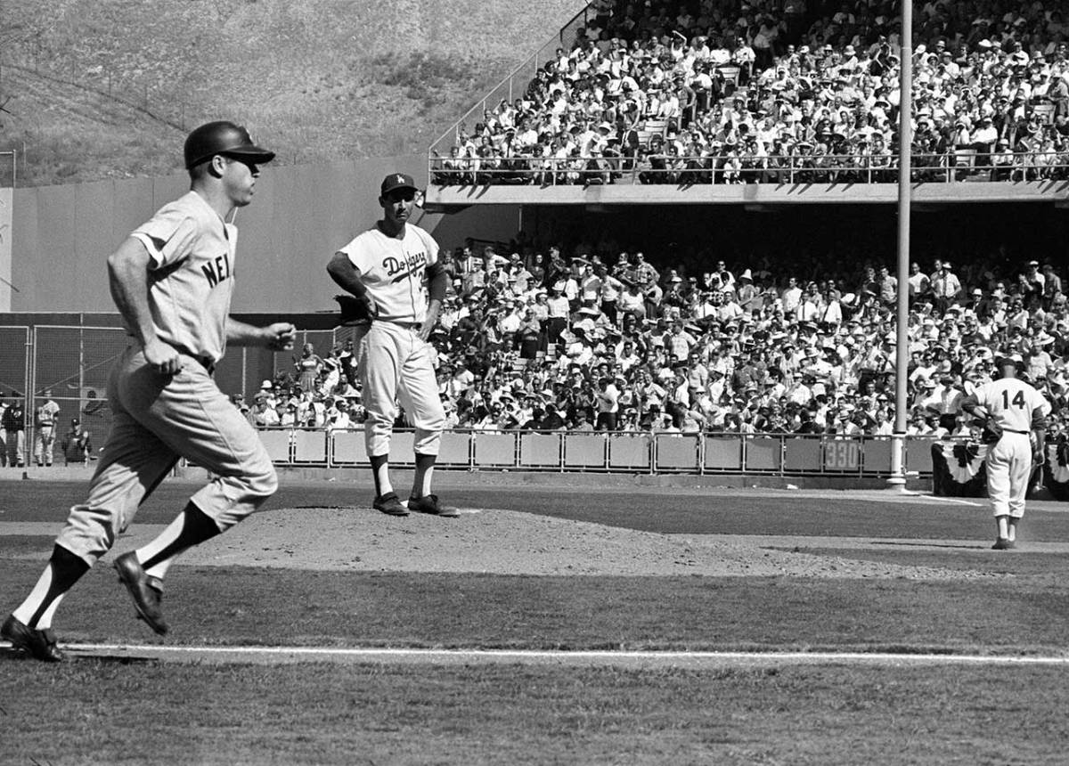 A disgusted Koufax watches Mantle round the bases after hitting his only homer of the Series.