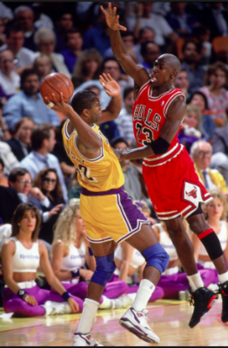 Jordan applies some defensive pressure on Magic Johnson