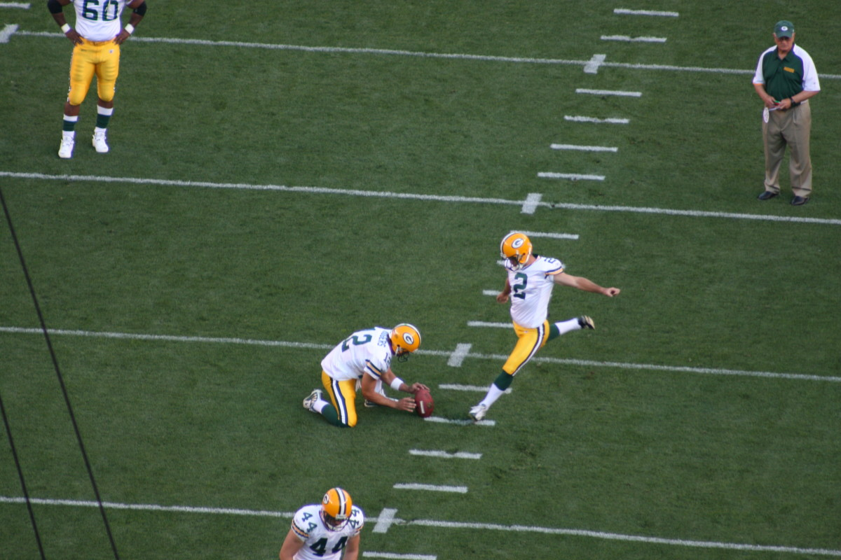 Mason Crosby practicing kicking a field goal.