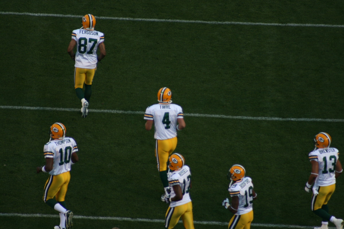 Bret Favre taking the field during a pre-season game against the Steelers in his final season as a Packer.