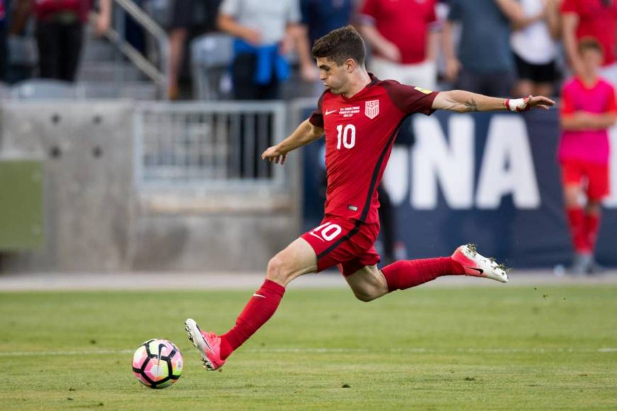 Christian Pulisic taking a hard shot while playing for the U.S. Men's National  Soccer Team.