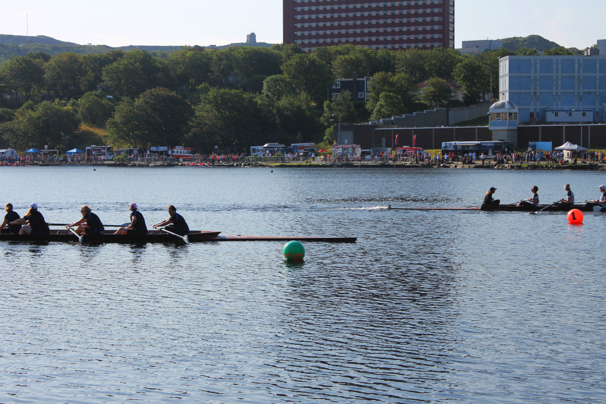 The record breaking M5 team crossing the finish line just ahead of Siobhan Duff and her record defending crew.