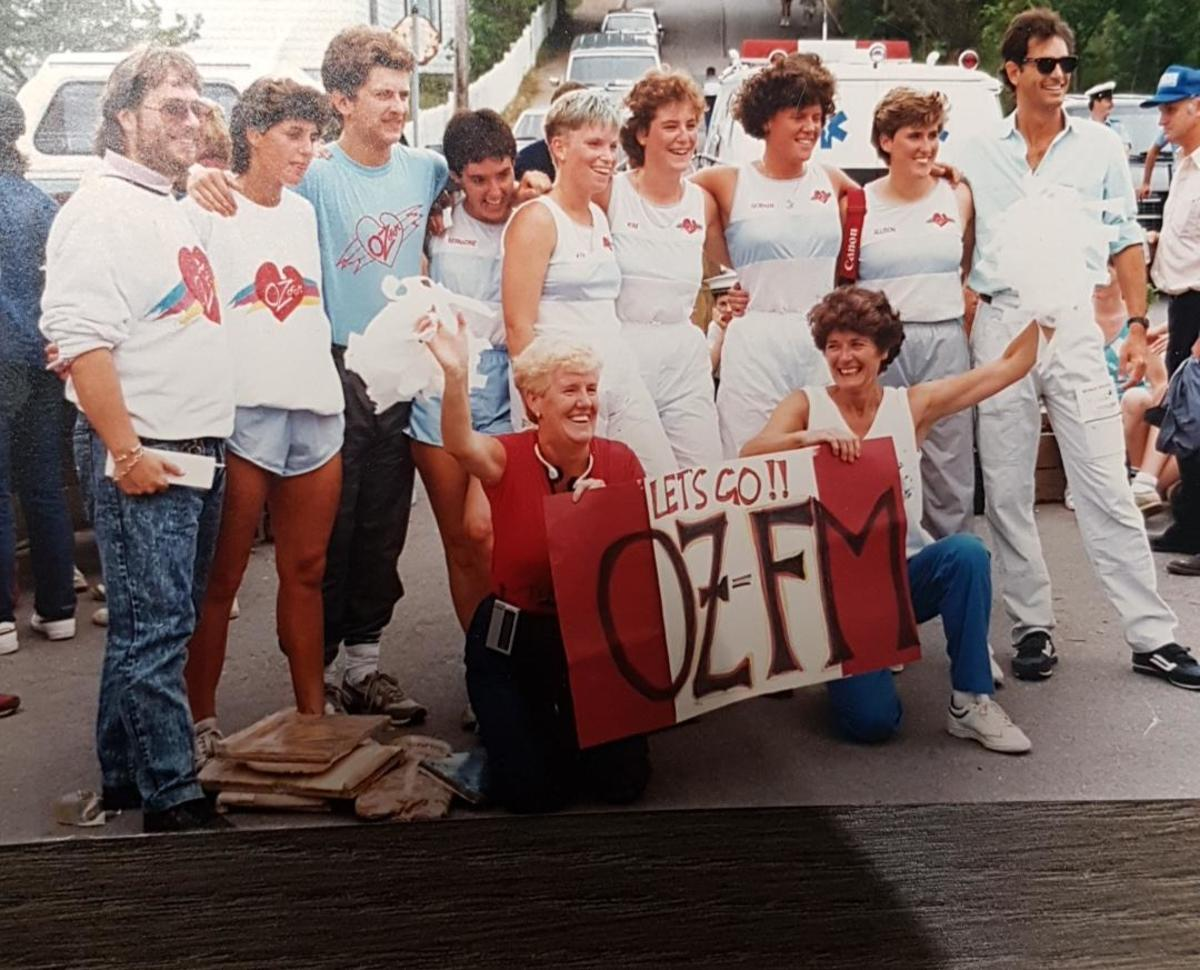 1987 OZFM Women's Crew (author's wife Kim is 6th from left)  l to r: Bruce Morel, Leona Rockwood, Abby Whiteway, Bernadine Ring, Kim Fudge, Kim Power, Siobhan Duff, Allison Carroll, Scott Sterling. With banner: Patricia Power, Shannie Duff.