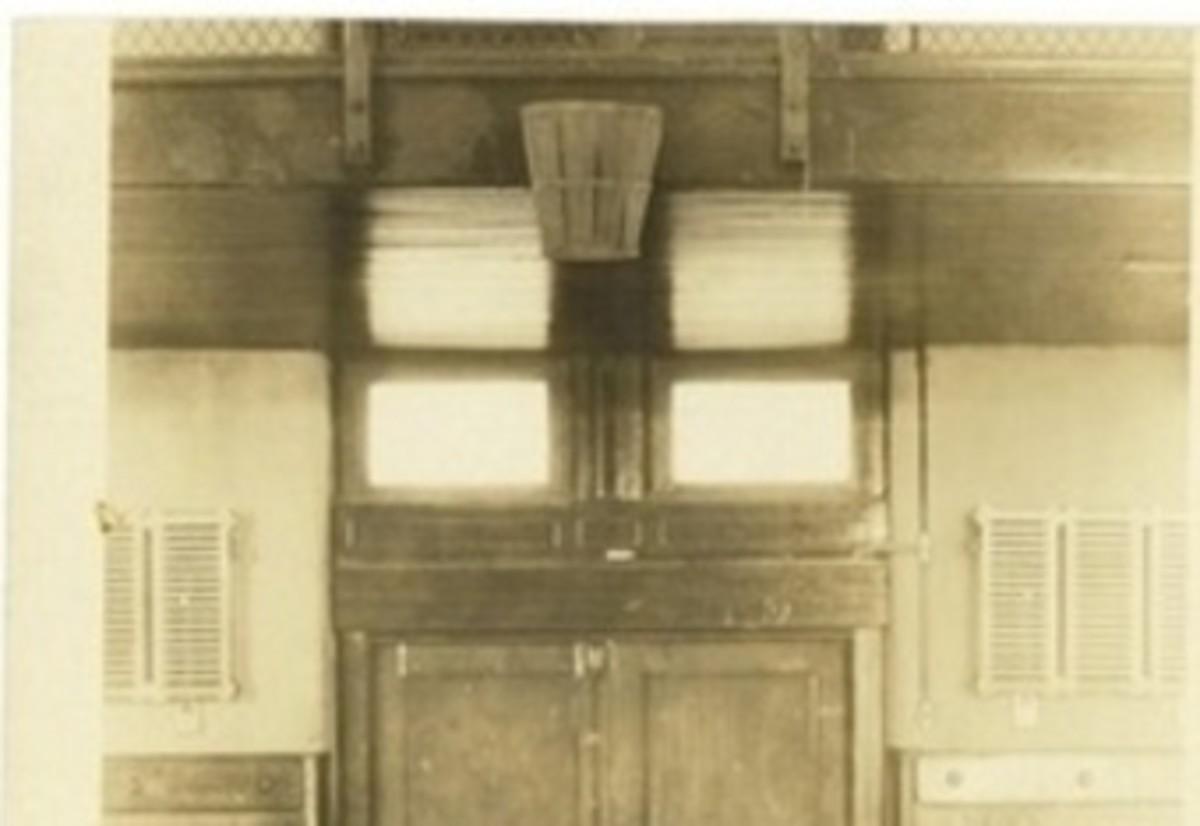 A peach basket at end of a gymnasium.