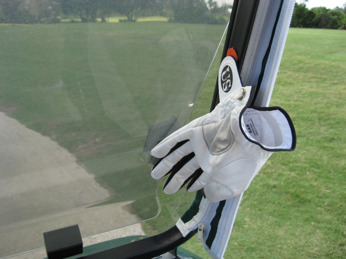 If you use your own cart on the course, attach a strip of velcro on the frame. This is a handy place to attach a glove to dry when you change gloves. I keep 3 on mine, ready to switch.