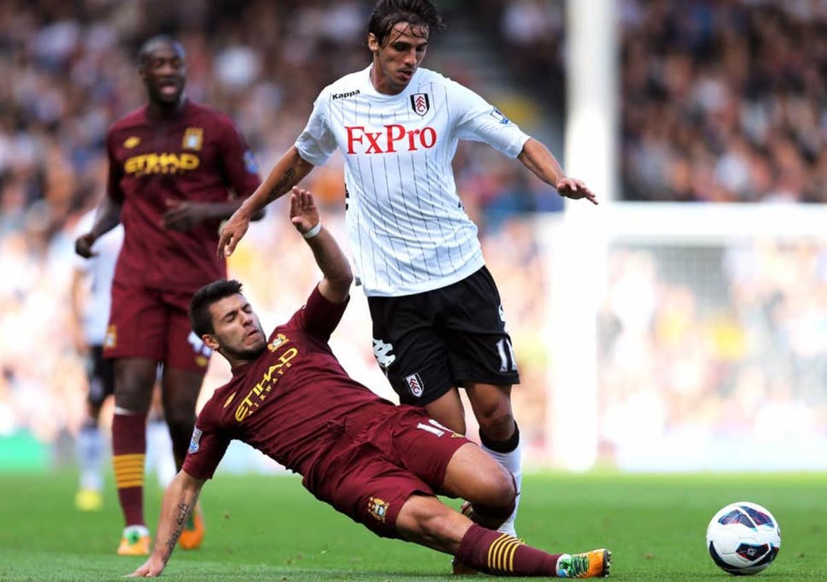 Aguero tackling Ruiz.