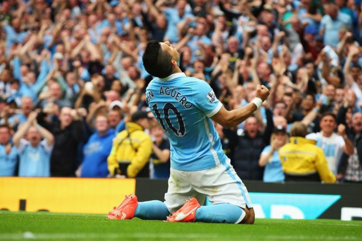 Aguero celebrating after scoring the opening goal of a match.