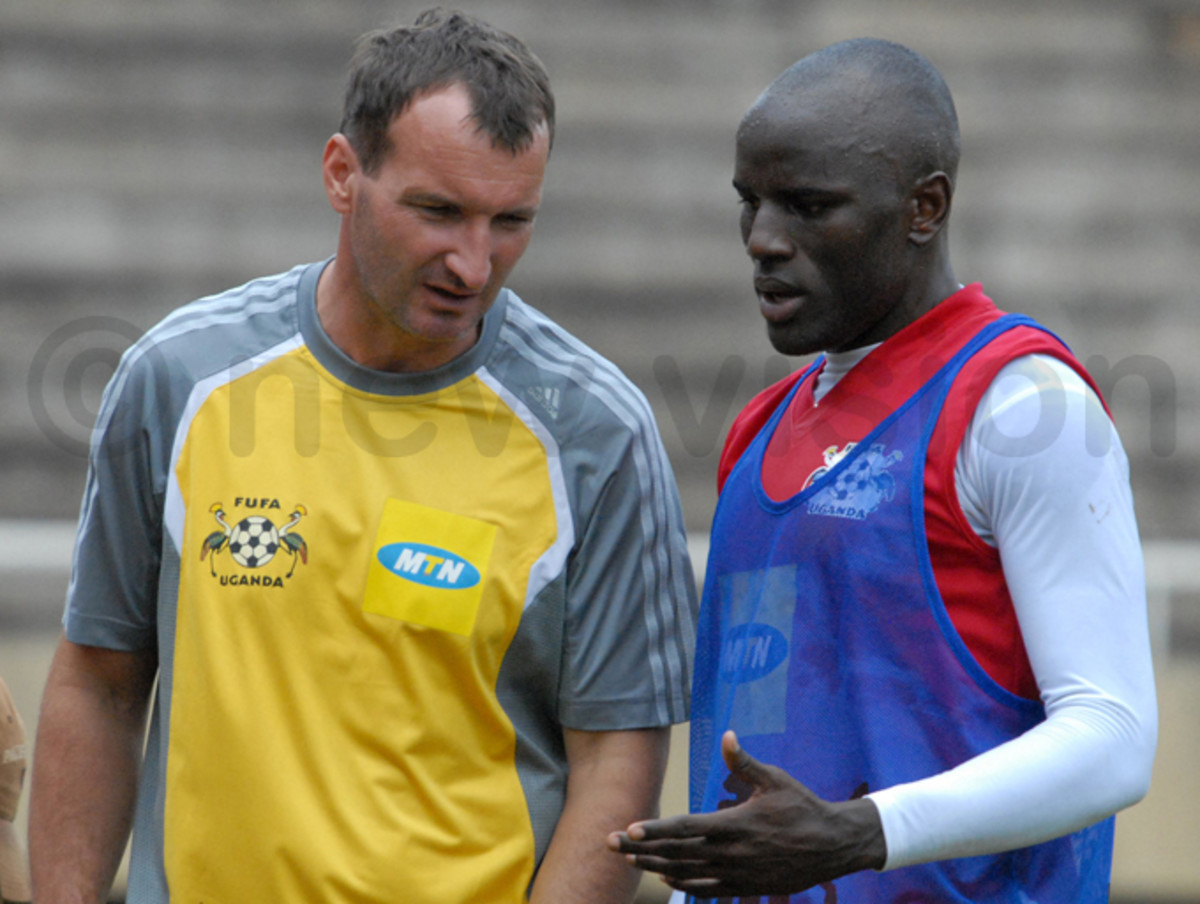 Czaba Laszlo (left) discusses footballing matters with Geoffrey Massa during a training session in 2008. Laszlo was one of three prominent coaches to help Uganda get back on the map.