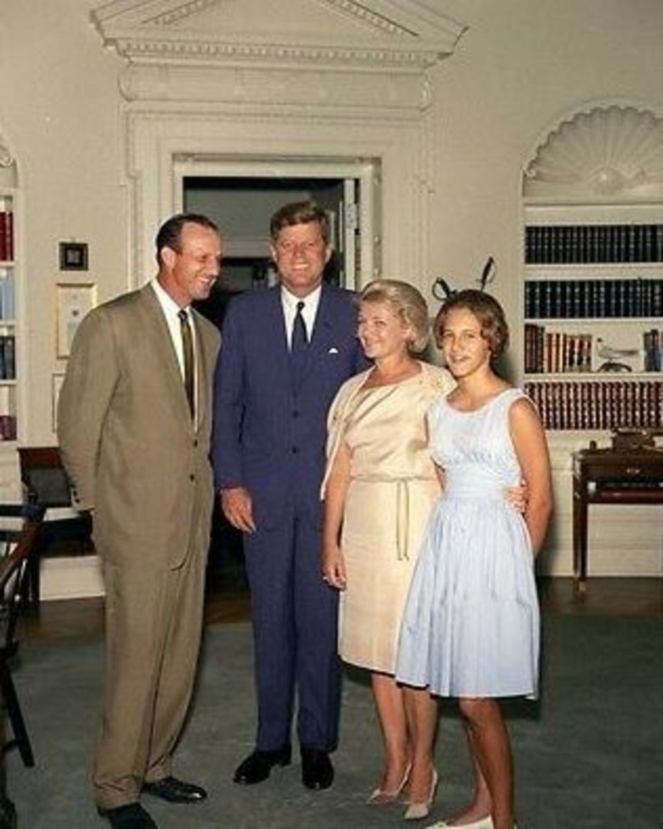 Stan Musial visits the President John F. Kennedy at the White House. Stan's wife Lil is next to President Kennedy.