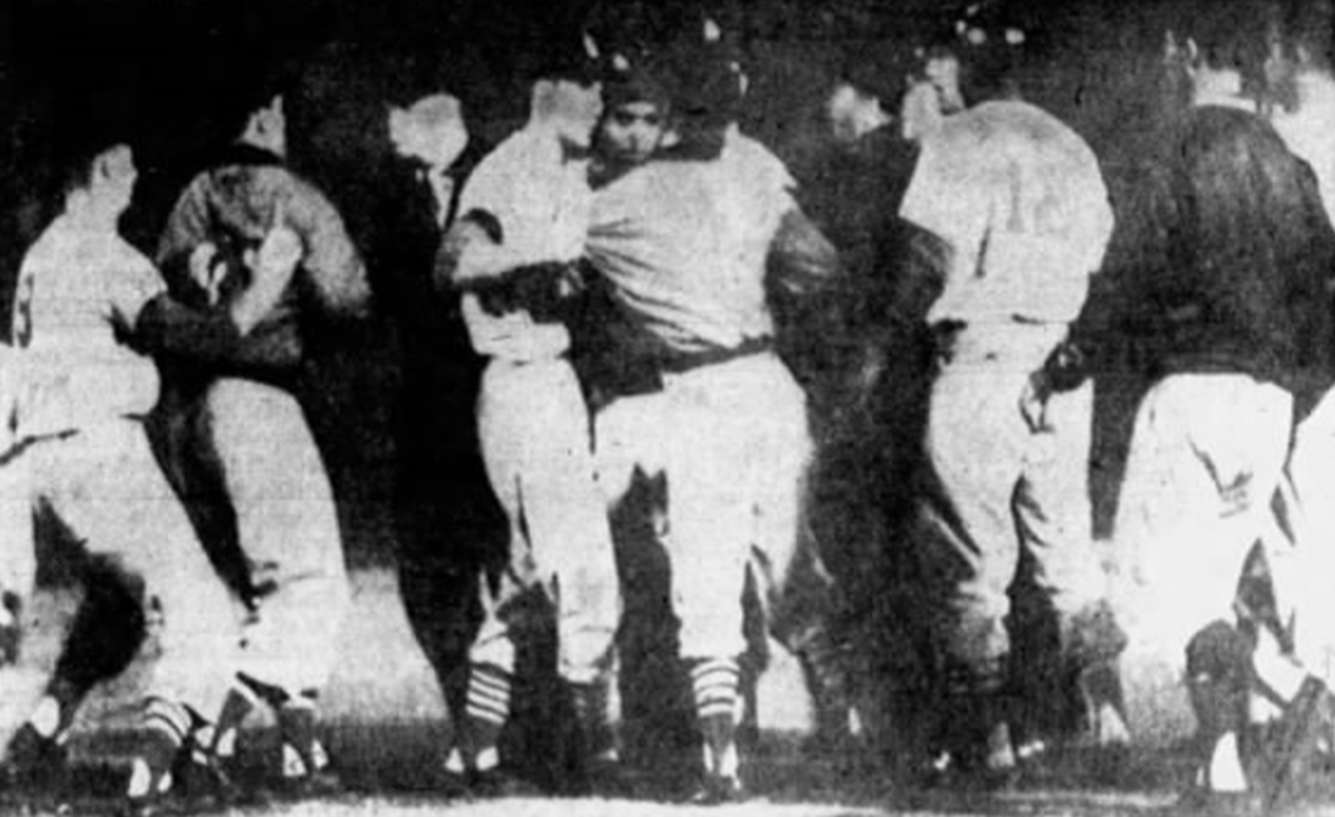 Players and coaches for the Dodgers and Cardinals argue on the field after Don Drysdale hit Joe Cunningham with a pitch during a game. The pitch was seen as intentional by St. Louis, though Drysdale denied any wrongdoing.
