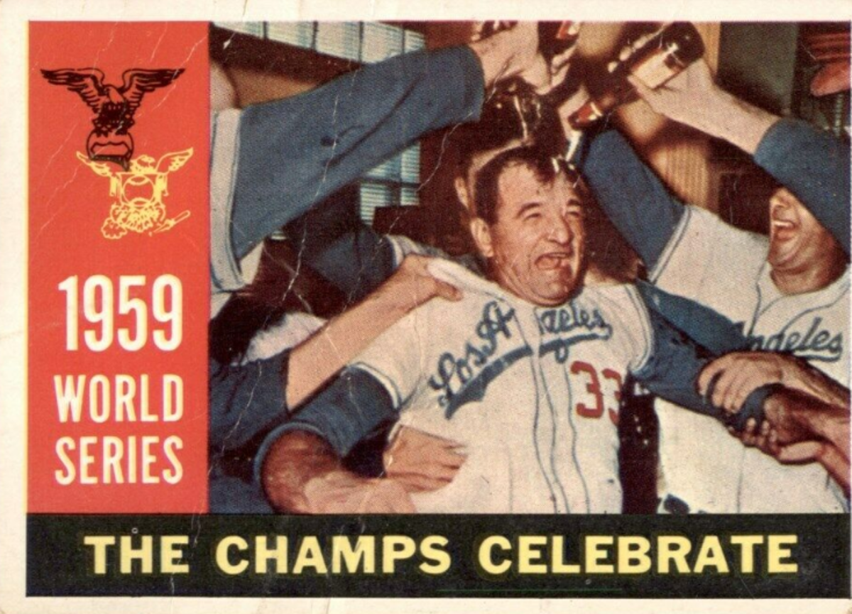 Despite some controversy in late August, pitching coach Joe Becker was all smiles after the Dodgers won the World Series, as depicted on this 1960 Topps baseball card. Becker made critical comments of Don Drysdale, leading to a public back-and-forth.