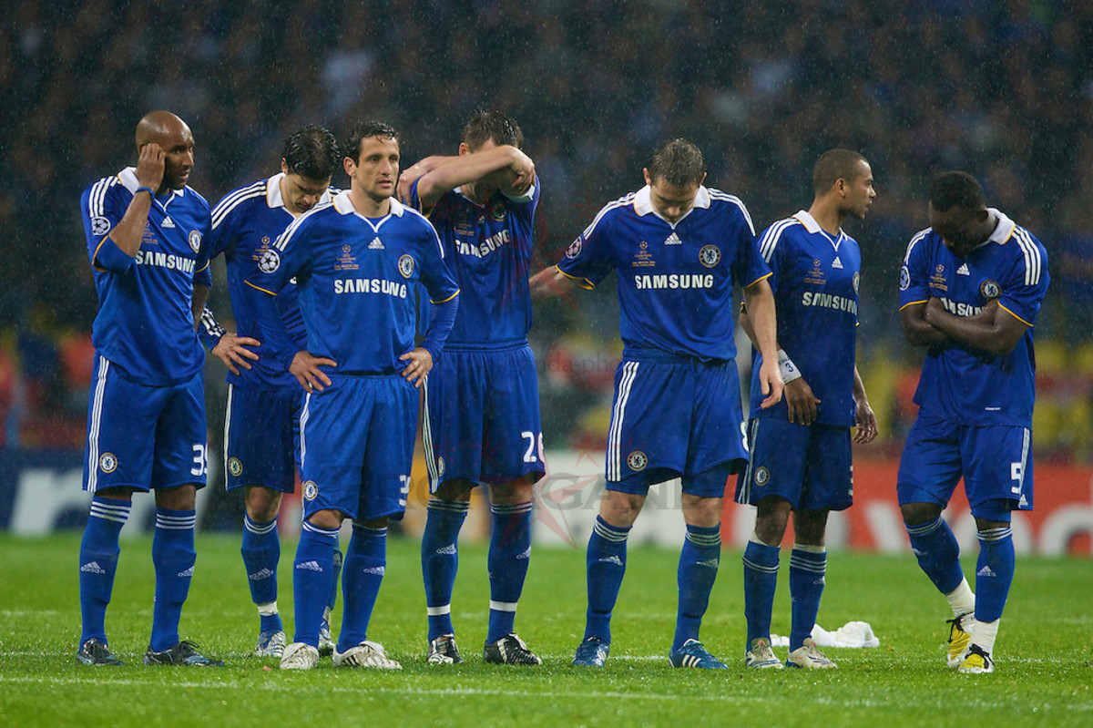 Chelsea team watches as they lose out at the 2008 Champions League Final