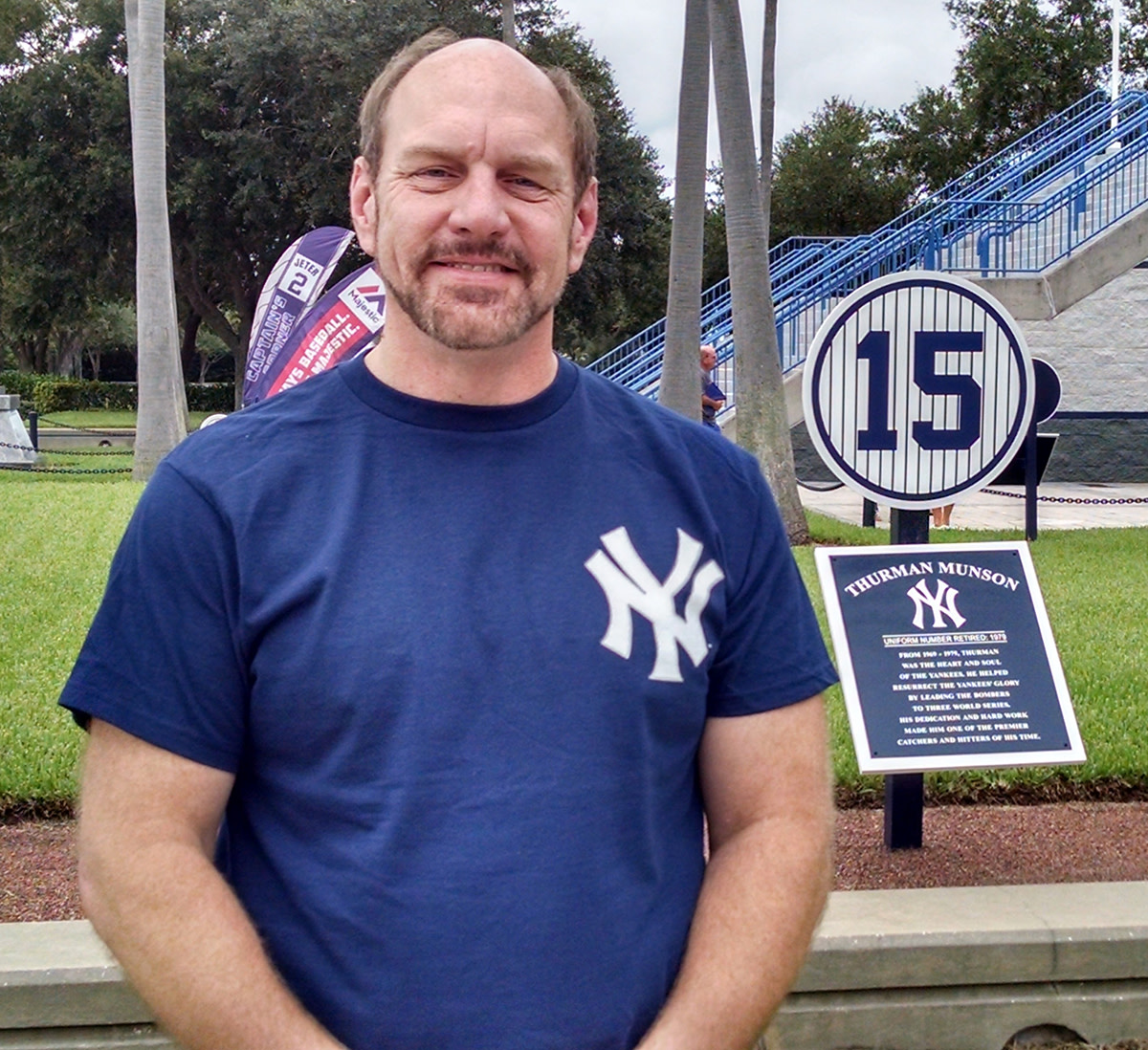 The author near a memorial plaque for Munson at Steinbrenner Field in Tampa.