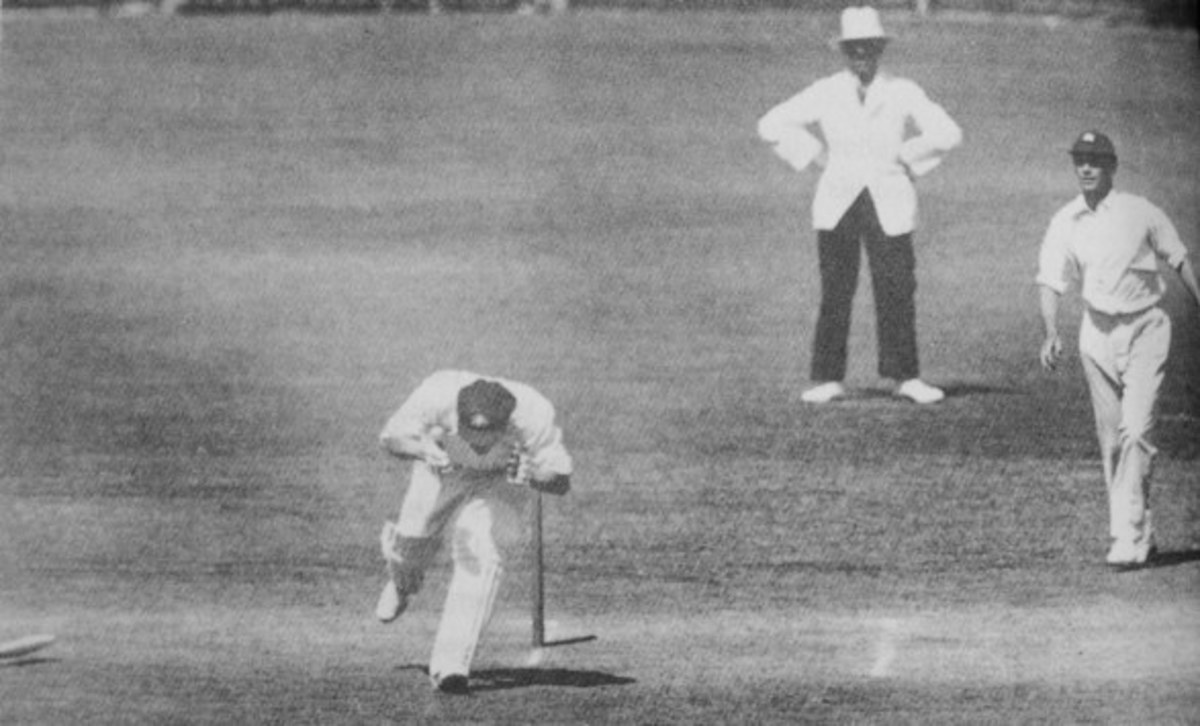 Australia's Bert Oldfield staggers away from the crease after suffering a fractured skull.