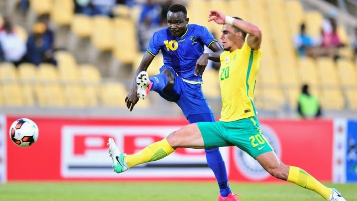 Players battle for possession during a quarterfinal of the 2017 COSAFA Cup in Rustenberg, South Africa. Tanzania upset the hosts en route to a third place finish.