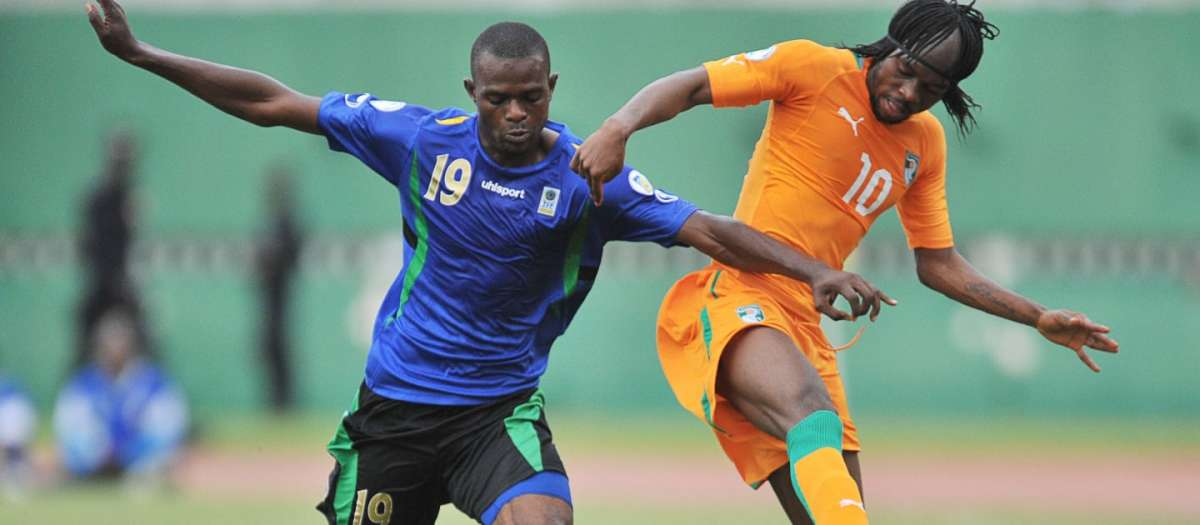 Shaban Nditi  (#19) of Tanzania battles for possession with Côte d'Ivoire's Gervinho (#10) during a 2014 FIFA World Cup qualification match in Abidjan's Stade Félix Houphouët-Boigny. on June 1, 2012.