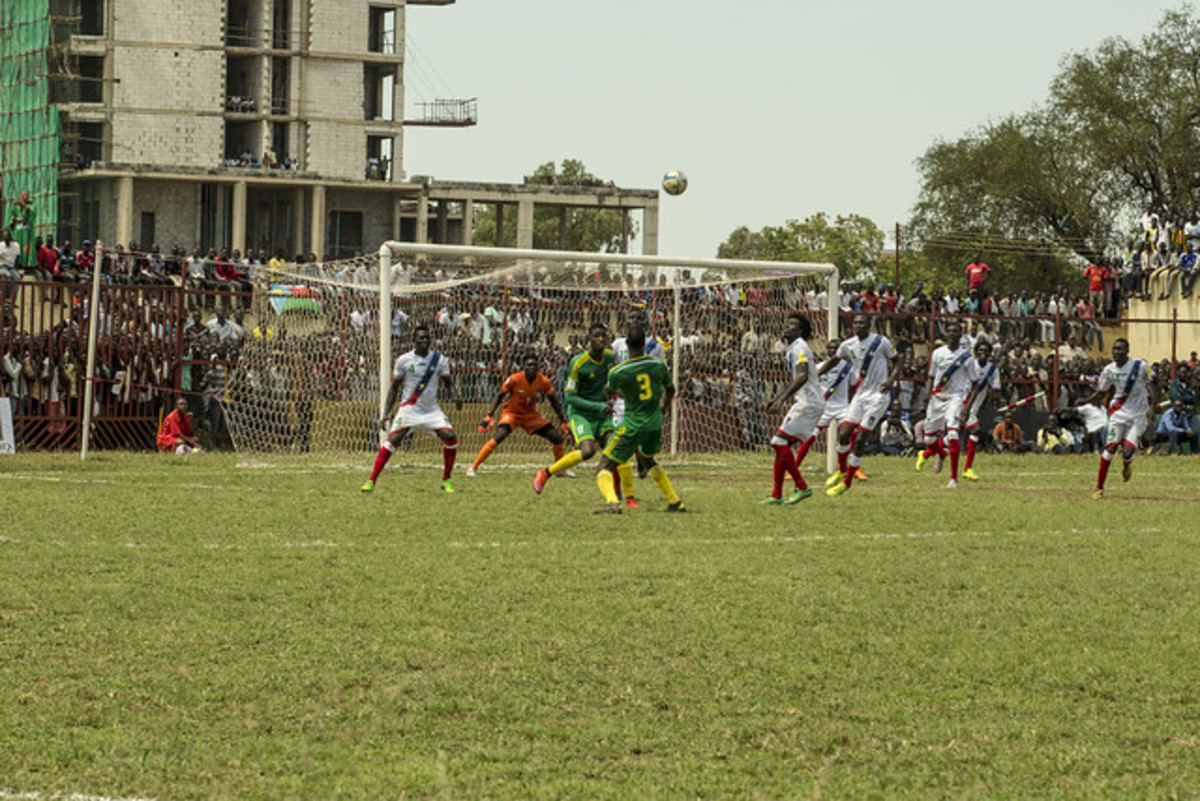 Taghiyoullah Denna (green #17) and Aly Abeid (green #3) are in action for Mauritania during a 2018 FIFA World Cup qualifier in Juba, South Sudan. This qualifier spanned two days during October 2015 due to torrential rain.