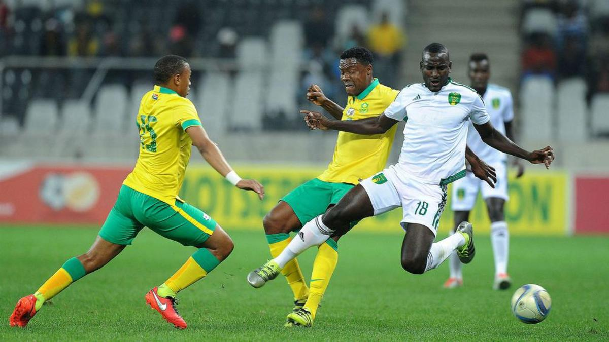 A Mauritanian player battles for possession with two South African players during a 2017 Africa Cup of Nations qualifying match in Nelspruit, South Africa. With the 1-1 draw in this match, Mauritania finished second in its qualifying group.