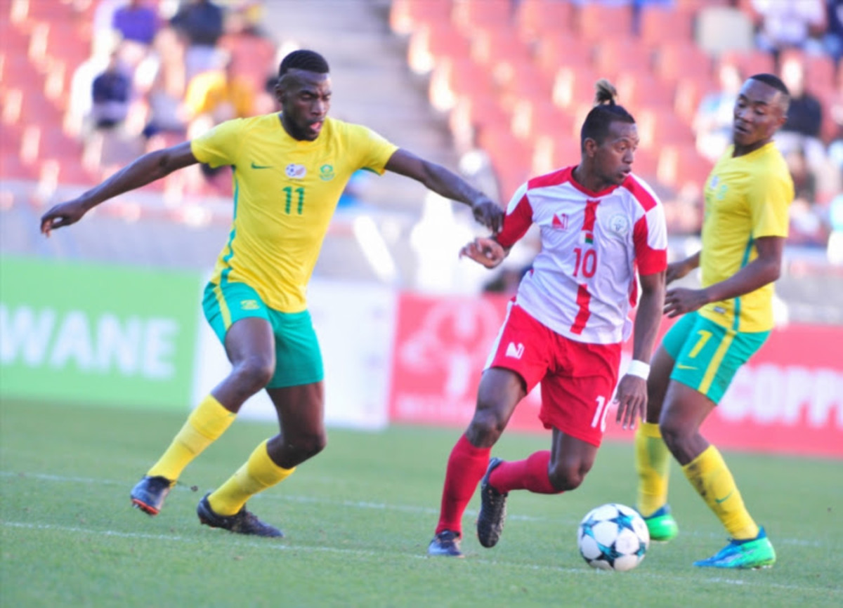 Madagascar's Andriamirado Hasina (#10) battles for possession with South Africa's Matlhari Makaringe (#11) during a 2018 COSAFA Cup quarterfinal in Polokwane, South Africa. Madagascar eliminated the hosts on a penalty shootout.