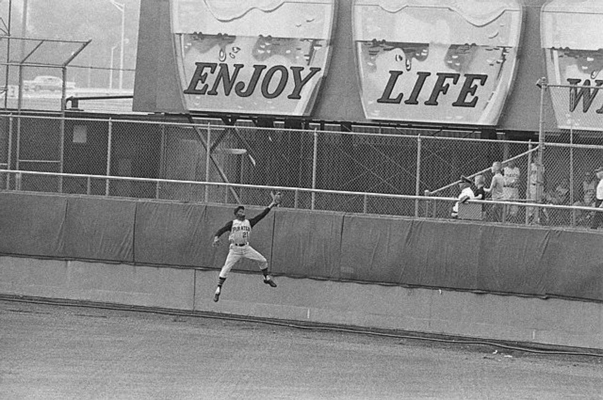 Roberto Clemente About to Hit the Wall After a Catch