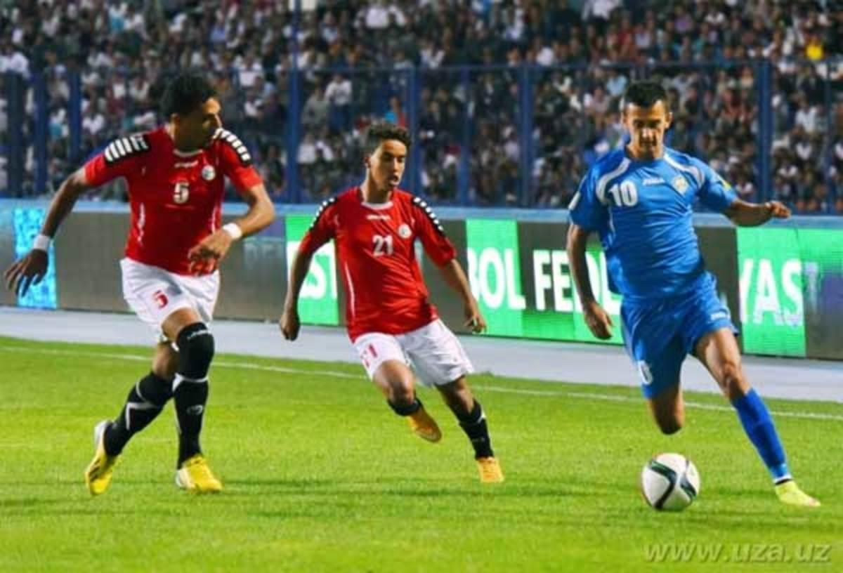 Abdulmuain Al-Jarshi (#5) and Ahmed Al-Sarori (#21) chase Uzbekistan's Sardor Rashidovb (#10) during a qualifier against Uzbekistan at Pakhator Central Stadium in Tashkent, Uzbekistan on Sept. 3, 2015.