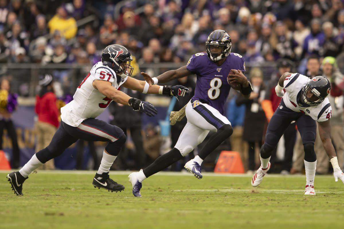 Lamar Jackson evades a defender while rushing during the 2019 season.