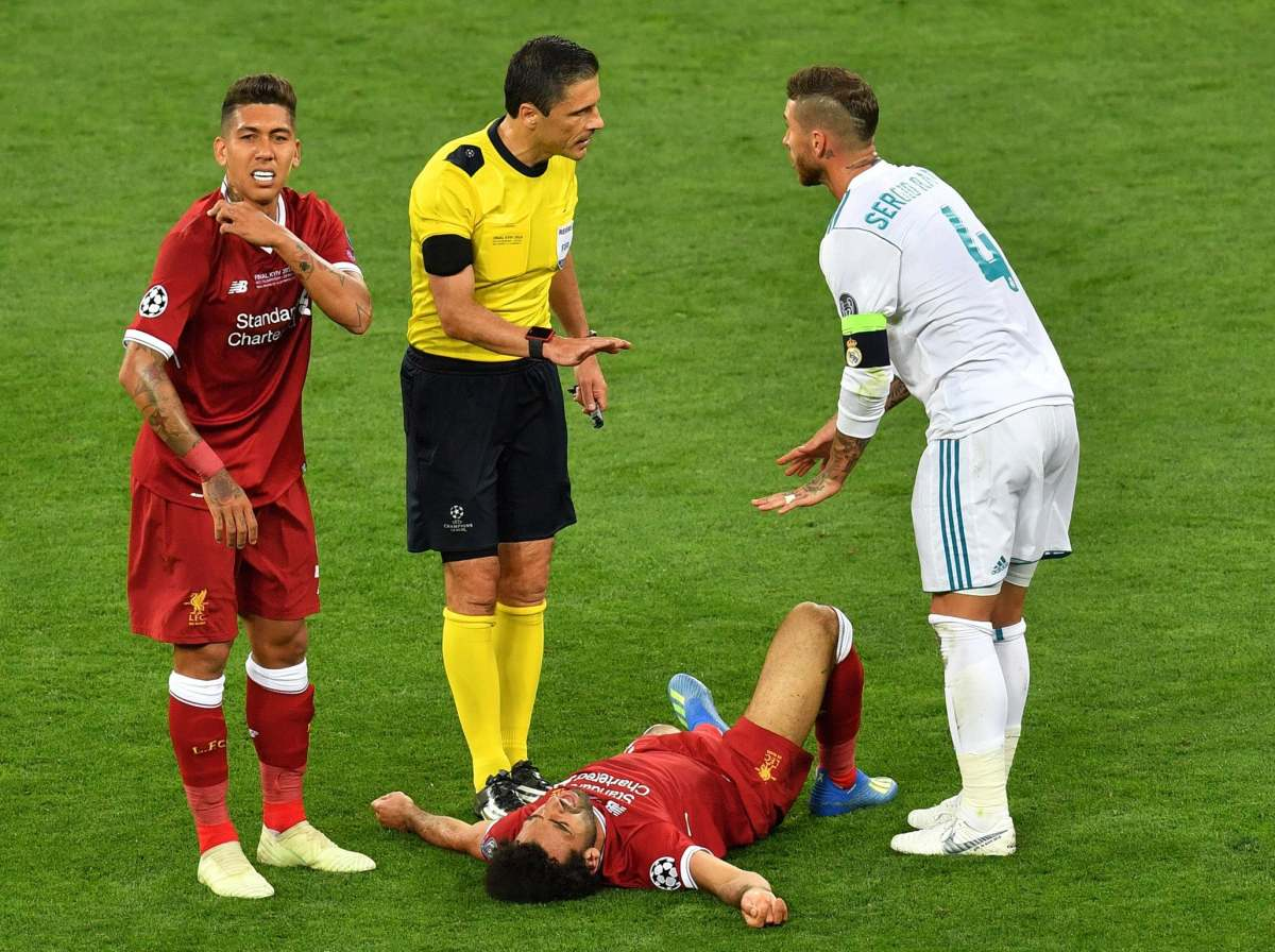 Reaction from Ramos, the referee and Firmino to Salah's injury.