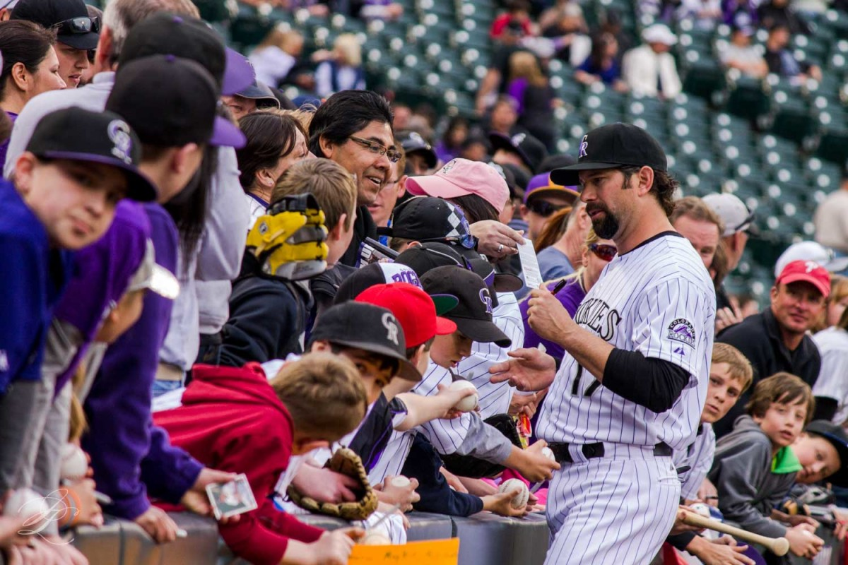 Former Colorado Rockies first baseman Todd Helton signs autographs for fans before a 2013 game. Helton is the greatest Colorado Rockies player of all-time.
