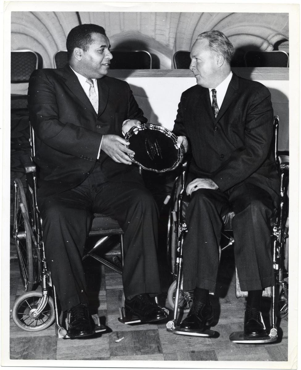 Former Dodgers Hall of Famer Roy Campanella (left) shares a moment with former Boston Mayor John F. Collins. Campanella was forced into a wheelchair after an automobile accident prematurely ended his baseball career.