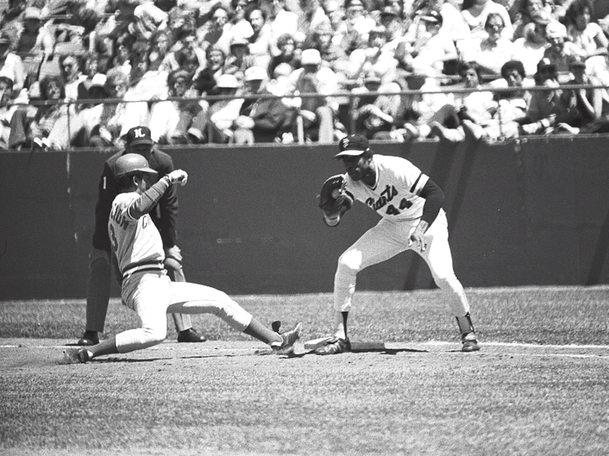 Former San Francisco Giants first baseman Willie McCovey takes a throw at first base against the Cincinnati Reds late in the 1980 season—his last year before retiring.